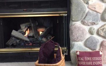 Basket by Fireplace.